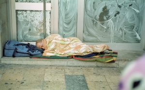 Sleeping on the street. Film street photo